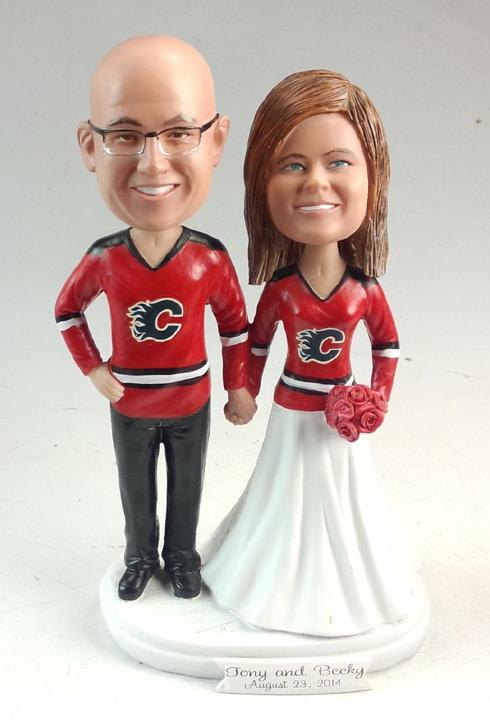 Bobble head wedding cake topper hockey themed