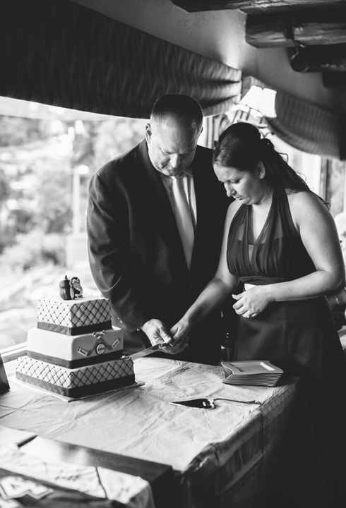 hockey bride and groom cut wedding cake