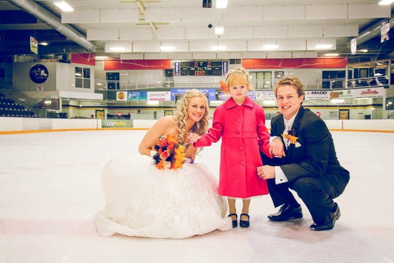 Bride and Groom on the ice - hockey themed wedding